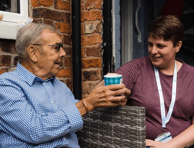 homecare in wilmslow client and carer having a chat over a coffee