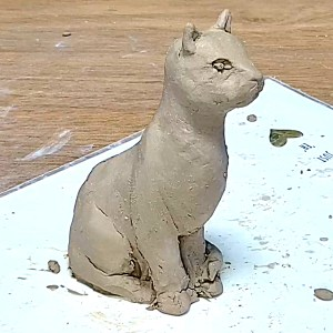 Cat sculpture from natural clay