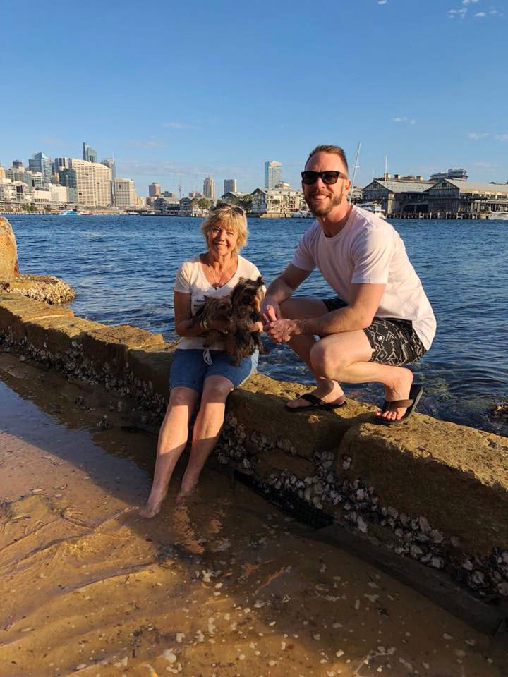 Picture of Devan and myself with dogs with Sydney Harbour behind us