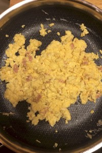 Scrambled eggs with cheddar cheese and ham