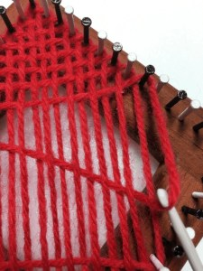 Pulling yarn down to bottom nail