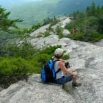 Megan sitting on long slab trail Mt. Dickey