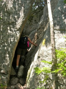 charlotte climbin up a crevice or crag on mt. Welch