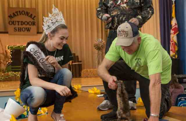 Miss Outdoors Jordan LeCompte gets a skinning lesson from Marcus Flowers  Photo: Jill Jasuta