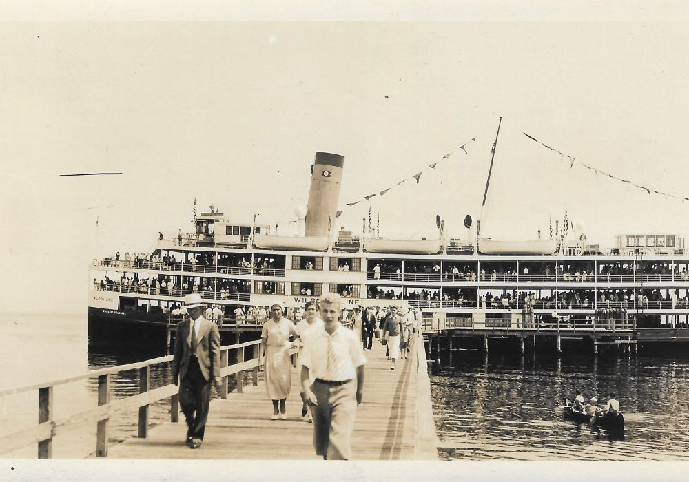"""Steamer named the """"State of Delaware"""" docked at end of long pier in Chesapeake Beach, MD, c.1935"""