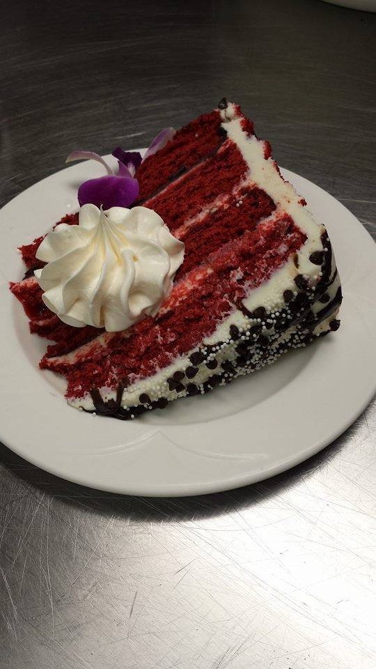 Red Velvet Cake topped with Whipped Cream and Edible Orchid - Chesapeake Conference Center