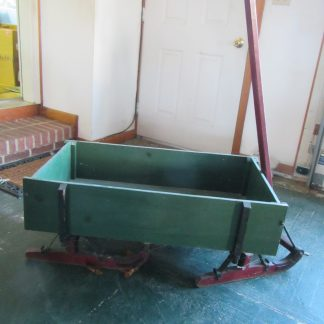 Green and Red Antique Sled