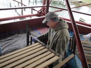 Tony Scraping the rust of bench legs