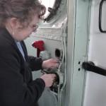 Heidi working on light switch