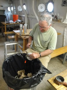 Ed Shaw cleans electrical fixtures