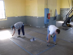 Photo by Tony Pasek Trez and Carolyn painting the floor.