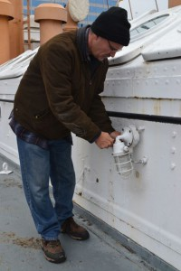 Photo by Anne Puppa Andy fixing light fixture on deck.