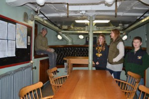 Photo by Anne Puppa Tony talking to tourists aboard the lightship while working in the wardroom.
