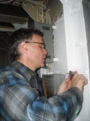 Andy Gray working on electrical components.