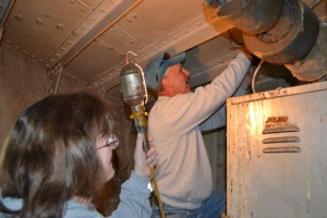 Donna and Jeff remove light fixtures.