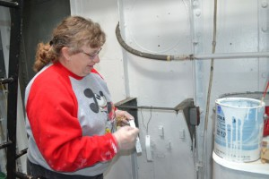 Heidi Moser painting a braket.