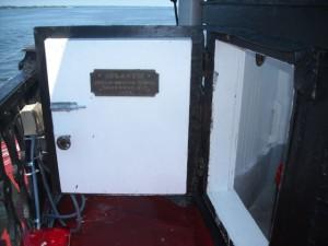 Plaque returned to lantern door.