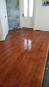 The floor shines after a coat of varnish was applied.