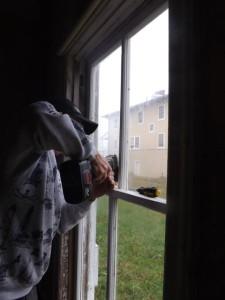 Hobie putting locks on windows.