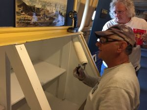 Tony and Paula working on display cabinet.