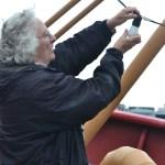 Paula changes bulb on overhead lights.