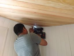 Juan nails the final board in the ceiling - YAY!