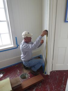 Jeff works on wall.
