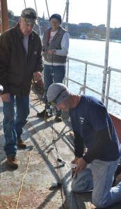 Rob, Jeff, and Tony work on overhead Lights