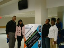 Students in the Student Center with the Giveaway Poster