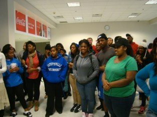 Students waiting for the results of the giveaway drawing in the Student Center