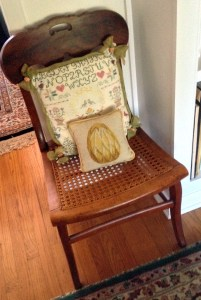 Chair one of a pair ($18 for both) from  Smithfield Barn, Downingtown. Sampler pillow embroidered by me and other pillow a gift