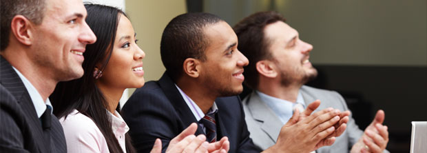 A group of young professionals smiling at a business meeting.