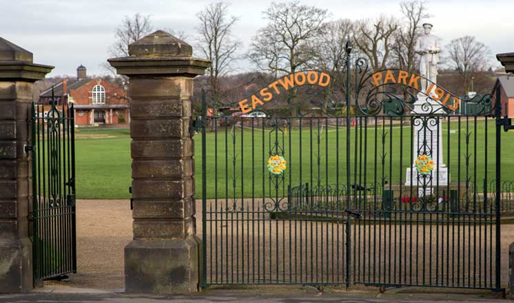 Black iron gates to Eastwood Park where Hasland Village Hall is located.