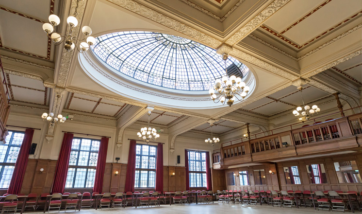 The Ballroom at the Winding Wheel with wood panelled walls and a domed glass window in the ceiling.