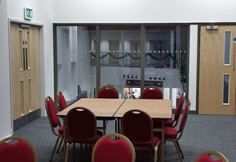 The Main Hall at the Assembly Rooms in Chesterfield set up with two tables.