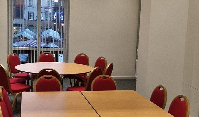 Meeting Room 2 at the Assembly Rooms in Chesterfield set up with two meeting tables.