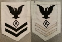 """Specialist """"A"""" 2/c rating badge for dress whites. Both chevrons are sewn onto the backing material while the """"crow"""" and insignia are directly embroidered which dates this rating badge to World War II."""