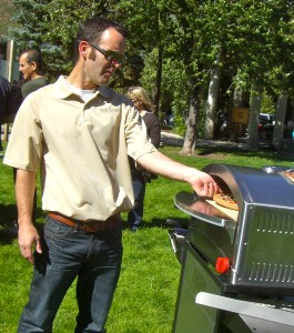 Steve McGrath of Camp Chef shows off a new pizza oven.