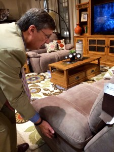 DeVon Gledhill, a manager at the R.C. Willey store in Draper, demonstrates a push-button recliner.