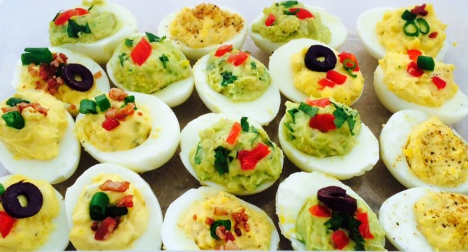 Old-school deviled eggs are switched -up as Ranch Deviled Eggs, Guacamole Deviled Eggs, and Old Bay Deviled Eggs. Photo by Valerie Phillips