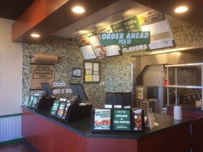 At Wingstop, you order at the counter and your food is brought to your table.