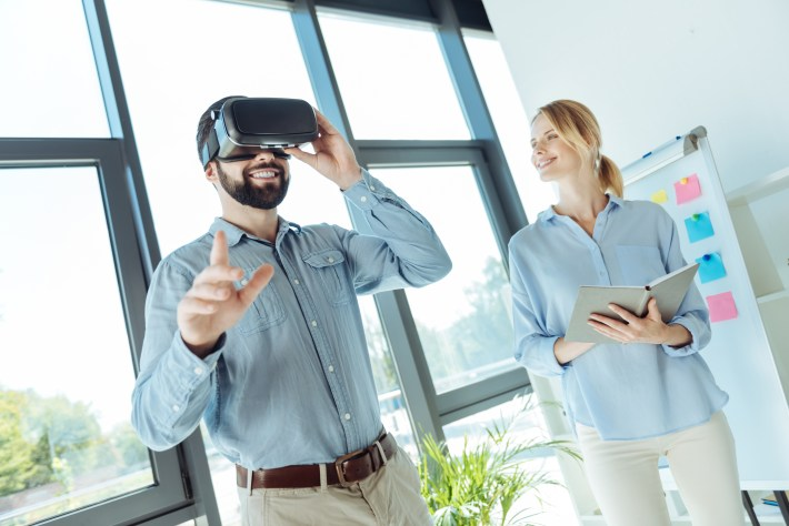 Man with VR headset in office.
