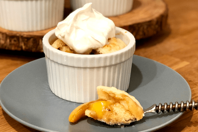 Individual Peach Cobbler | Sweet peaches baked with brown sugar and topped with a soft biscuit...yes please!