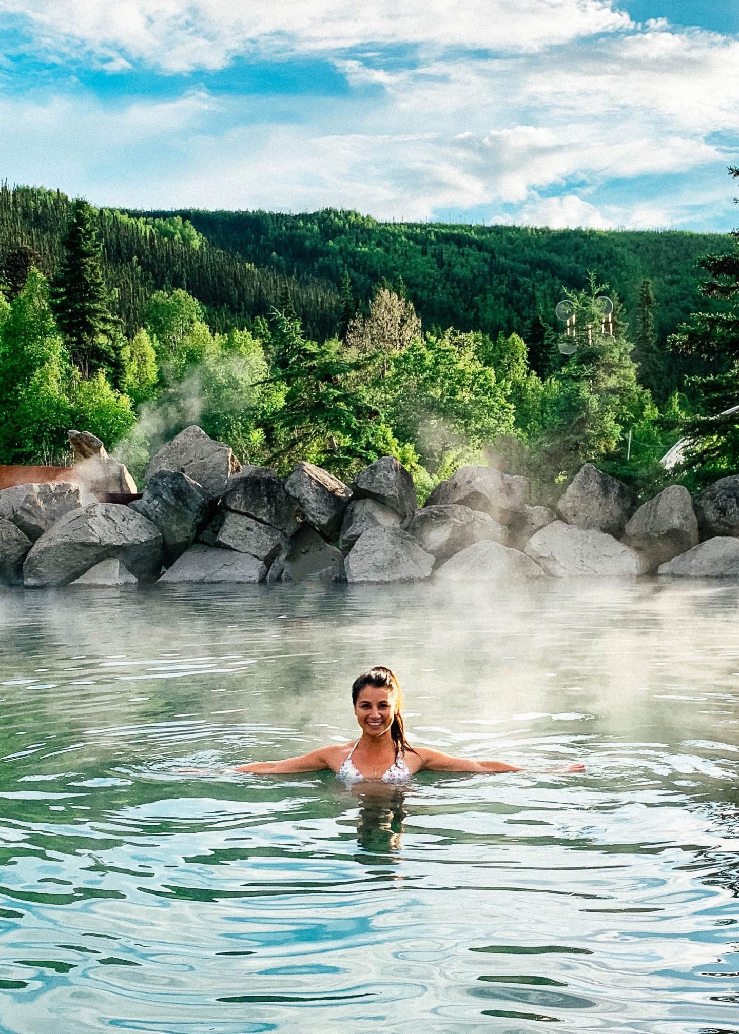 Alaska's Chena Hot Springs Resort has a beautiful outdoor hot spring surrounded by nature.