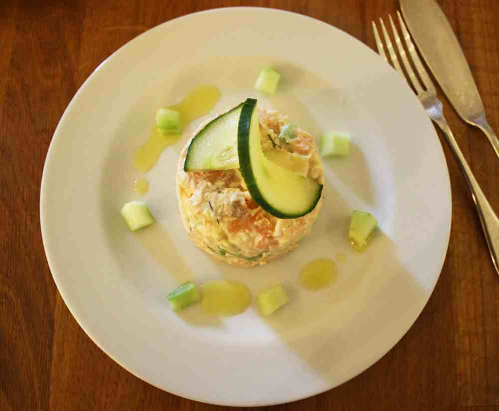 These summer salmon timbales are light and delicate. Smoked and lightly cooked salmon with cucumber and avocado in a creamy dill and lemon dressing.
