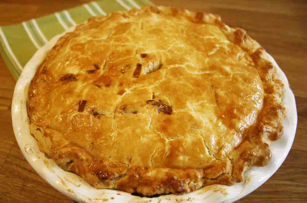 Chicken and Leek Pie. Melt in the mouth double crust pastry pie filled with chicken, leeks and bacon in a simple creamy sauce.