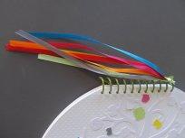 La spirale et les rubans aux couleurs des tables
