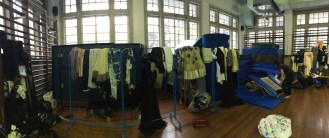Behind the scenes: final rehearsal clothes organized in the gym - a glamorous setting indeed.