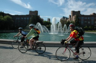 Bicycle riders around Drumheller Fountain at the heart of University of Washington's campus in Seattle. Over 80% of those traveling to campus travel by means other than the single occupancy vehicle.