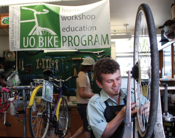 """Student bike mechanics from the University of Oregon Bike Program work on the program's bicycle fleet in their on-campus facility, affectionately known as """"the Barn."""" Photo: Briana Orr"""